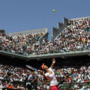 Li Na serves to Maria Sharapova during Thursday's first women's semifinal. Li won 6-4, 7-5 to advance to her second straight Grand Slam final.