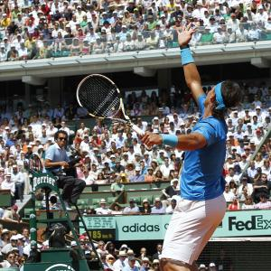 Spain's Rafael Nadal serves to Britain's Andy Murray during their semifinal match on Court Philippe Chatrier. Nadal won 6-4, 7-5, 6-4.