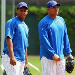 The Cubs demonstrative ace melted down after Chicago closer Carlos Marmol (left) blew his second chance for a win in as many starts. After the game Carlos Zambrano compared the Cubs to a