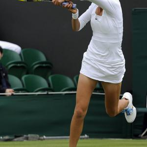Victoria Azarenka of Belarus returns to Slovakia's Magdalena Rybarikova on the first day of the 2011 Wimbledon Championships.