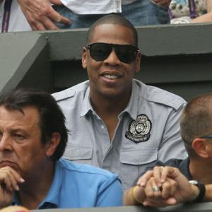 Music mogul Jay-Z watches Monday's fourth-round showdown between Rafael Nadal and Juan Martin del Potro.