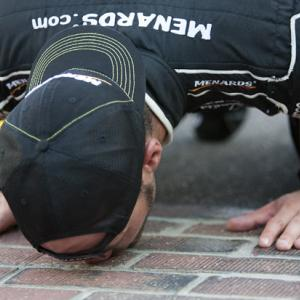 After driving to Victory Lane at the third annual Brickyard 400 in 1996, Dale Jarrett grabbed his crew and headed for the thin strip of bricks at the finish line. They flipped their hats around, leaned down and laid a big ol' smooch on the one-yard strip of exposed bricks. In that instant, a tradition was born.  Every NASCAR driver now dreams of kissing the bricks. SI.com proudly presents the most notable kisses from years past.