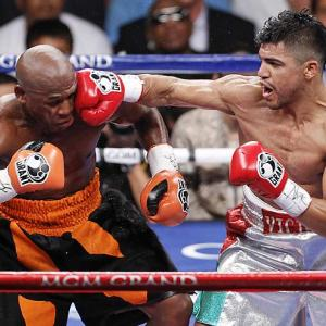 Floyd Mayweather (left) stayed undefeated by getting the best of Victor Ortiz in the fourth round in Las Vegas.
