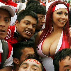 Welcome to another titillating installment of  Did You See That? , the gallery that dares to keep you abreast of the world of sports in all its bust-out, offbeat glory. Up front this week, we present model Daisy Araujo and supporters at a World Cup qualifying soccer game between Chile and Peru in Santiago.
