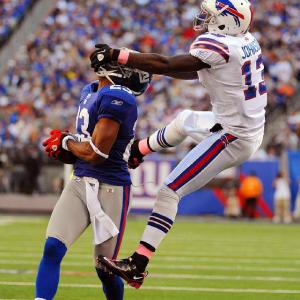 Bills' wide receiver Steve Johnson's facemask penalty can't stop Corey Webster from intercepting this Ryan Fitzpatrick pass. Webster and the Giants won the game 27-24.
