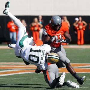 The Cowboys are on quite a roll. A week after showing concussion-like symptoms against Missouri, star receiver Justin Blackmon returned in notable fashion, catching 13 balls for 171 yards and two touchdowns. But Oklahoma State also impressed on defense, disrupting Robert Griffin III (pictured) and limiting him to one touchdown pass and two interceptions.