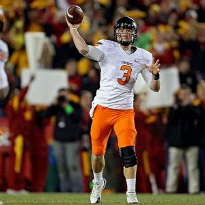Last week:  42-of-58 passing for 476 yards, three TDs and three INTs in a 37-31 loss to Iowa State   Season (11 games):  355-of-486 passing for 4,111 yards, 34 TDs and 12 INTs  Weeden's yardage in a loss to Iowa State was as gargantuan as we've come to expect during his rise up this list. He's now thrown for 1,401 yards over the past three games to go along with 12 touchdowns -- numbers worthy of a certain bronze trophy. But he made costly mistakes against Iowa State. After the Cyclones cut the Cowboys' lead to 24-17 late in the third quarter, Weeden managed one touchdown and two picks over his next 22 attempts -- he came in averaging 47.5 attempts between picks -- and ended the night with his third pick of the game. His chances of winning the Heisman, just like the Cowboys' chances of winning the BCS title, were greatly deflated by the loss. In fact, the setback may have cost Weeden a shot at making it to New York.   Next up:  Saturday, Dec. 3 vs. No. 12 Oklahoma