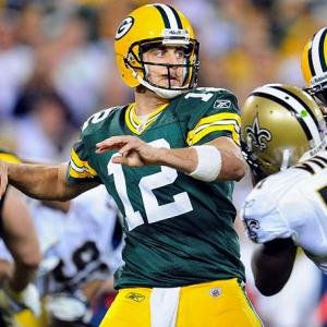 Aaron Rodgers' passer rating topped 100 through 12 consecutive games this season, breaking the record shared by Tom Brady and Steve Young.  Rodgers has a 123.3 passer rating through 13 games, throwing for 39 TDs with just six interceptions as he leads the Packers to a potentially undefeated season.   Completed 27 of 35 passes (77.1%)  for 312 yards and three TDs.