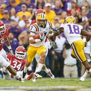 Arkansas jumped to a 14-0 lead, but it was all LSU from there. Jordan Jefferson played his best game of the season, making plays with his feet and through the air, and the Tigers piled up 286 yards on the ground as a team. But the play of the game was undoubtedly made by Tyrann Mathieu (pictured), who turned the momentum with a 92-yard punt return touchdown in the second quarter.