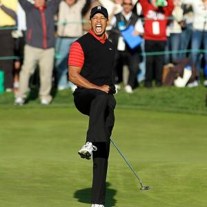 Tiger Woods celebrates after sinking his final putt to win the Chevron Challenge in Thousand Oaks, Calif., on Sunday.
