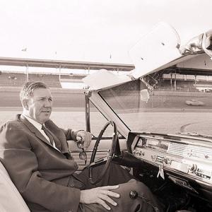 NASCAR founder Bill France Sr. surveys Daytona International Speedway from a car in 1965.