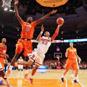 St. Johns' Amir Garrett attempts a layup against Syracuse big man Baye Moussa Keita.