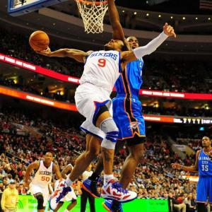 Philadelphia's Andre Iguodala attempts an acrobatic layup against Oklahoma City's Serge Ibaka.