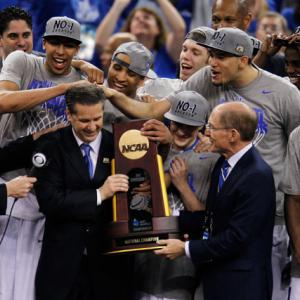 Athletes celebrate championships in a number of unique ways. Some spray champagne all over their teammates. Others find their families for an emotional post-victory embrace. And some like to find their coaches and mess up their well-coiffed hair, as Kentucky players did to John Calipari after Monday's national championship victory. Here's a look at some of these hair-raising celebrations.