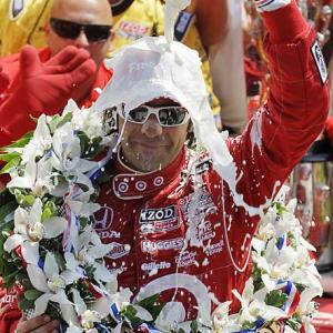 Dario Franchitti celebrates winning his third Indy 500.