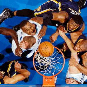 The Orlando Magic's Jason Richardson, Glen Davis and Ryan Anderson; and Indiana's Roy Hibbert, David West and Danny Granger have their eye on the prize as they battle for a rebound in Game 4 of the NBA Eastern Conference quarterfinals.