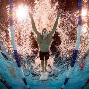 Michael Phelps cruised to victory in his signature event, the 200-meter butterfly, at the U.S. Olympic trials in Omaha, Neb., on June 28. The 27-year-old will be competing in this event for the fourth time in his Olympic career in London.