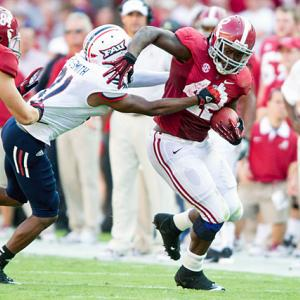 Alabama continued its early-season dominance by routing Florida Atlantic. AJ McCarron threw for 228 yards and three touchdowns, and running back Eddie Lacy (pictured) carried 15 times for 106 yards. The Tide defense continued to stonewall the opposition, limiting the Owls to 110 yards of total offense.