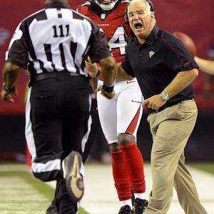 After two weeks of intense media scrutiny and considerable verbal abuse from both players and coaches, the NFL replacement officials received some extra backing from the league on Sept. 20 in the form of a memorandum. The league has been contacting teams and warning them that if the replacement officials are not respected, fines or even suspensions could be forthcoming. Several games, most notably last Monday night's between the Broncos and Falcons, have been marred by the officials misapplying the rule book and missing some blatant penalties. More and more players have started to sound off in the wake of games that are noticeably chipper, more physical, and at times seemingly uncontrollable.   Atlanta coach Mike Smith and wide receiver Roddy White bark at referee Dwayne Strozier during the Monday night mess against Denver.