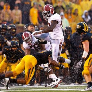 Another game, another easy victory for the No. 1 Crimson Tide. Alabama pummeled Missouri behind its punishing stable of running backs. Eddie Lacy (pictured) carried 18 times for 180 yards and three touchdowns, and T.J. Yeldon carried 18 times for 145 yards and two scores. Through six games, 'Bama has now outscored its competition 243-45.