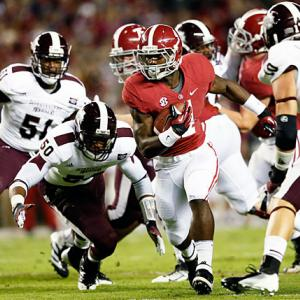 Two teams entered 7-0, but only one emerged unscathed: Alabama crushed visiting Mississippi State to back up its No. 1 ranking. Quarterback AJ McCarron threw for 208 yards and two touchdowns, while T.J. Yeldon (pictured) paced the rushing attack with 84 yards and a score. The 'Bama defense stifled the Bulldogs. Dan Mullen's team didn't score until backup Dak Prescott connected with Robert Johnson in the closing moments of the fourth quarter.