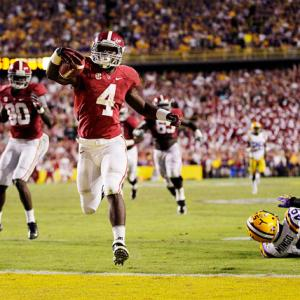 Alabama may have delivered a win -- and a drive -- for the ages. Down 17-14 with fewer than two minutes remaining, 'Bama gained possession on its own 28-yard line following a missed Drew Alleman field goal. AJ McCarron, who appeared rattled for most of the second half, completed three consecutive passes to junior wideout Kevin Norwood. Then the Tide completed the comeback: McCarron hooked up with freshman back T.J. Yeldon (pictured), who deked a defender and raced 28 yards to the end zone. Nick Saban's squad improved to 9-0, while LSU's Zach Mettenberger silenced many critics in defeat. He completed 24-of-35 passes for 298 yards and a touchdown.