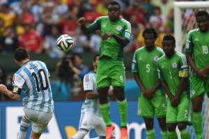 Lionel Messi bends his free kick up and over Nigeria's wall to give Argentina a 2-1 lead on Wednesday.