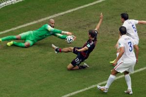 Tim Howard extends to reach a cross before Germany's Thomas Muller can during the USA's 1-0 loss to Germany, which was a good enough result to secure progression to the World Cup knockout stage.