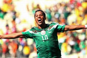 Giovani dos Santos celebrates his fantastic strike that opened the scoring in Mexico's knockout clash against the Netherlands.