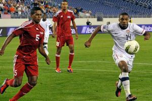 U.S. winger Joe Gyau, shown above right playing for the U.S. Under-23 national team, has signed with German power Borussia Dortmund.