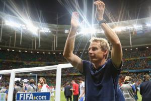 U.S. manager Jurgen Klinsmann applauds the fans after his Americans exited the 2014 World Cup with a 2-1 loss in extra time to Belgium on Tuesday.