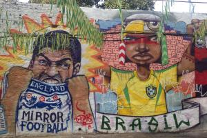 Soccer-themed graffiti is widely encouraged and accepted in Rio de Janeiro, with intricate artwork like the one photographed above lining the streets and favelas.
