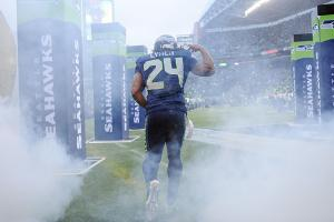 Marshawn Lynch ends holdout, returns to Seattle Seahawks training camp