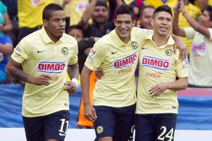 Raul Jimenez, center, celebrates with Michael Arroyo, left, and Oribe Peralta during his hat-trick performance against Puebla over the weekend.