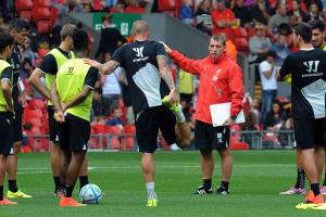 Manager Brendan Rodgers, third from right, has a tall task ahead of him at Liverpool in replacing Luis Suarez's production.