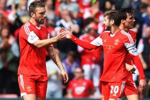 Rickie Lambert, left, and Adam Lallana have traded Southampton's red for Liverpool's as part of the Saints' offloading of talent this offseason.