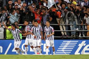 Matias Alustiza, left, celebrates a goal during his hat trick in Pachuca's win over Atlas in Liga MX.