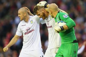 From left, Philippe Senderos, Nathan Baker and American goalkeeper Brad Guzan celebrate Aston Villa's 1-0 win over Liverpool.