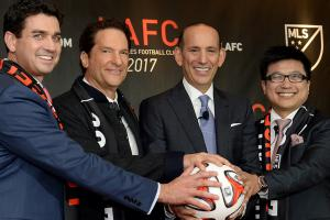 Majority owners of MLS' second LA franchise Tom Penn, Peter Guber and Henry Nguyen pose with MLS commissioner Don Garber at Thursday's unveiling.
