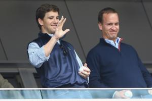 Eli Manning did not know how to react after Peyton won the Super Bowl