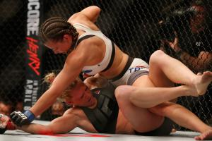 Miesha Tate defeats Holly Holm at UFC 196