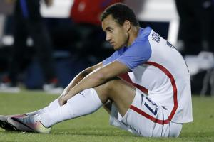 Jerome Kiesewetter sits in disappointment after the USA's loss to Colombia in Olympic qualifying