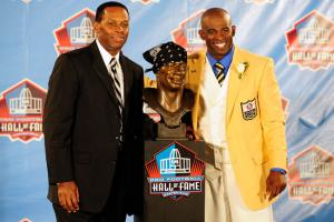 Eugene Parker (l.) accompanied his client Deion Sanders at the 2011 Pro Football Hall of Fame enshrinement ceremony.