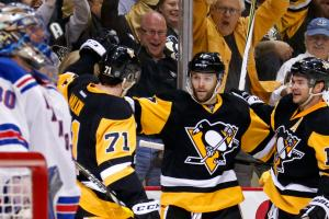 Penguins rout Rangers, advance to second round