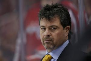 Watch: Isles coach Jack Capuano takes puck to face