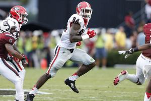 Bears trade up for No. 9 pick, take UGA's Floyd