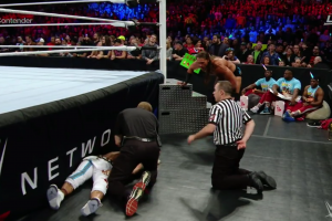 WWE tag team match stops after serious head injury