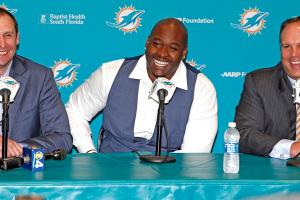Dolphins draft pick Laremy Tunsil with coach Adam Gase and head of football operations Mike Tannenbaum.