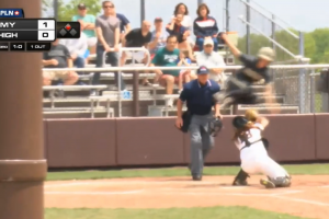 Army softball player leaps over catcher to score