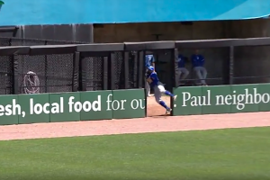 Watch: Player runs through door to make catch